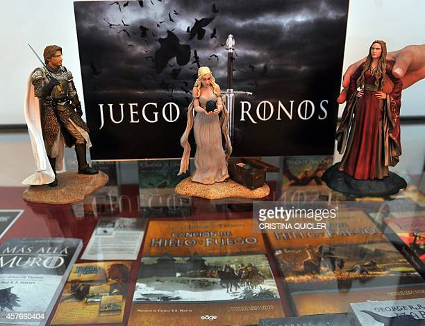 An employee arranges figurines from the series Game of Thrones on October 22 2014 as film crews began shooting part of the fifth season of the...