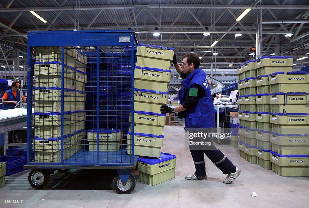 An employee arranges letter crates on a trolley in the main hall at the Russian Post automated sorting center in Podolsk, Russia, on Wednesday, Nov. 14, 2012. Alexander Kiselev, Russian Post's chief executive officer, needs to invest 200 billion rubles through 2020 to turn around a company that described its infrastructure as 'the most expansive, but the least efficient' in a strategy plan this year. Photographer: Andrey Rudakov/Bloomberg via Getty Images