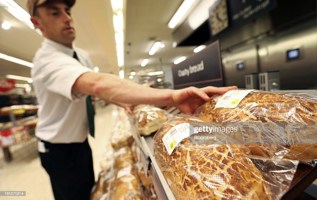 An employee arranges loaves of fresh bread in the bakery section of a William Morrison Supermarkets Plc grocery store in Erith, U.K., on Wednesday, Sept. 5, 2012. Morrisons announced that 60 percent of store openings will be in southern England next year as it shifts attention from its northern heritage. Photographer: Chris Ratcliffe/Bloomberg via Getty Images