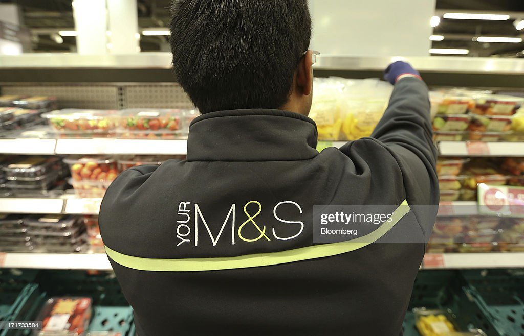 An employee arranges packaged fruit in the chilled food display cabinet at a Marks & Spencer Group Plc (M&S) food hall in the Westfield Stratford City retail complex in London, U.K., on Thursday, June 27, 2013. U.K. retail sales rose more than economists forecast in May as consumers spent more online and food sales increased at their fastest pace for more than two years. Photographer: Chris Ratcliffe/Bloomberg via Getty Images
