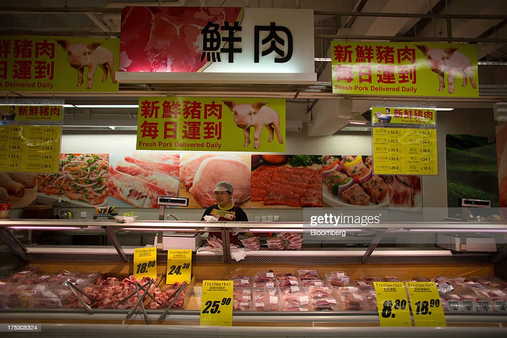 An employee arranges packaged pork at a ParknShop Superstore supermarket, operated by Hutchison Whampoa Ltd., in Hong Kong, China, on Thursday, Aug. 1, 2013. KKR & Co., the private-equity firm run by Henry Kravis and George Roberts, is evaluating a bid for Hong Kong supermarket chain ParknShop, according to two people with knowledge of the matter. Hutchison is seeking $3 billion to $4 billion for the chain and has asked potential buyers to submit bids by Aug. 16, people with knowledge of the process have said. Photographer: Lam Yik Fei/Bloomberg via Getty Images