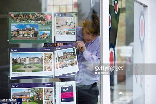 An employee arranges residential property advertisements in the window of a real estate agent in Guildford Surrey UK on Monday Sept 14 2015 In a...