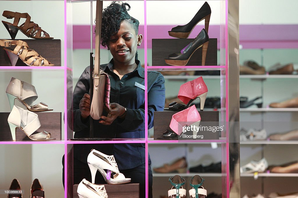 An employee arranges shoes at a Marks & Spencer Group Plc (M&S) store in The Westfield Centre shopping mall in London, U.K., on Monday, May 24, 2010. The company, the U.K.'s biggest clothing retailer, reports its full-year earnings tomorrow. Photographer: Jason Alden/Bloomberg via Getty Images
