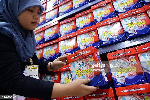 An employee arranges Unilever's Rinso laundry detergent at a Hypermart supermarket operated by PT Matahari Putra Prima in Karawaci Banten Indonesia...