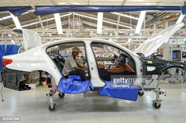 An employee assembles a BMW 530i sedan on the production line at a PT Gaya Motor plant in Jakarta Indonesia on Wednesday Aug 2 2017 BMW is scheduled...