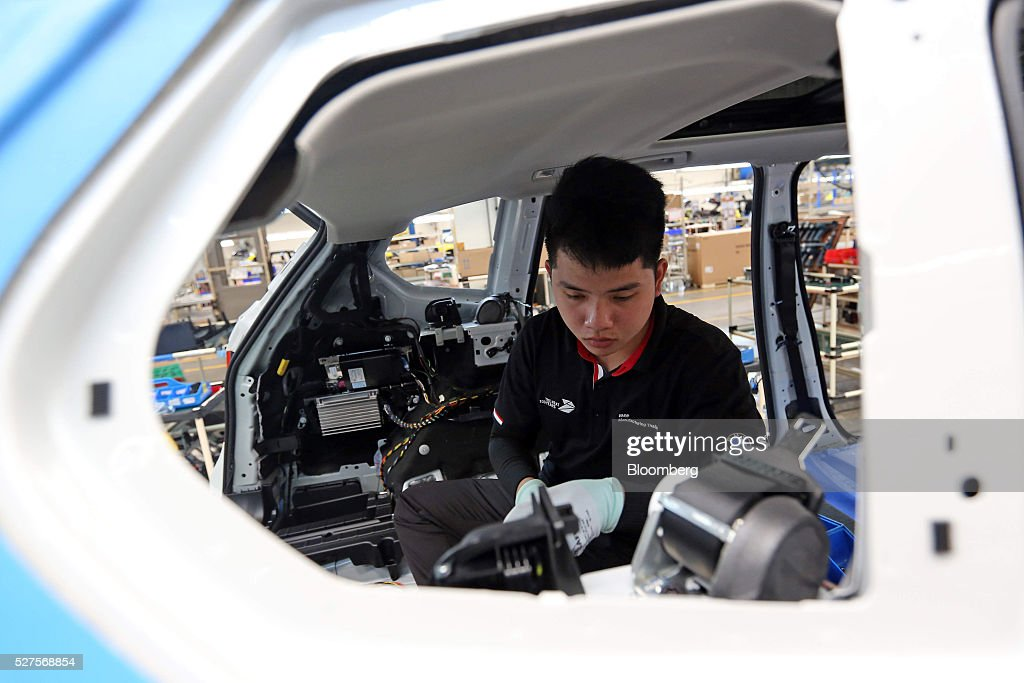 An employee assembles a BMW AG X3 vehicle at a BMW manufacturing plant in Pluak Daeng, Rayong Province, Thailand, on Tuesday, May 3, 2016. BMW's profit declined 2.5 percent in the first quarter on investment in new technologies like self-driving cars to defend its status as the world's biggest maker of luxury vehicles. Photographer: Dario Pignatelli/Bloomberg via Getty Images