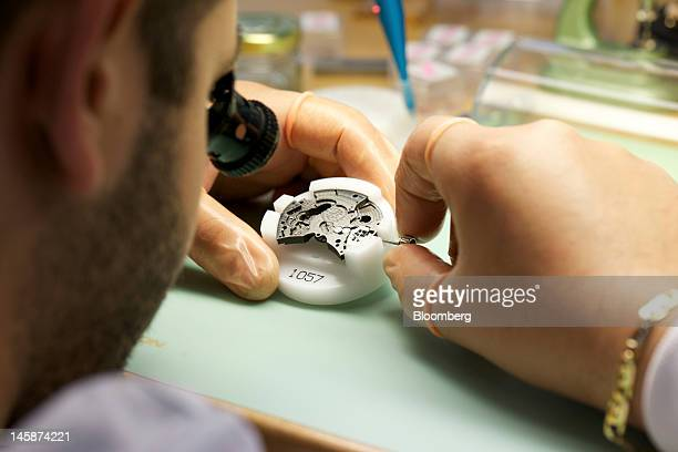 An employee assembles a Hublot SA 1057 wristwatch at the company's headquarters in Nyon Switzerland on Tuesday June 5 2012 Hublot SA Chairman...