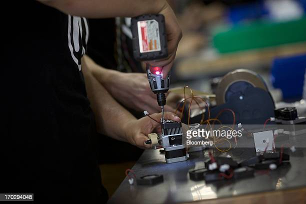 An employee assembles a Makerbot Industries LLC 3D Printer at the company's new factory in the Brooklyn borough of New York US on Thursday June 7...