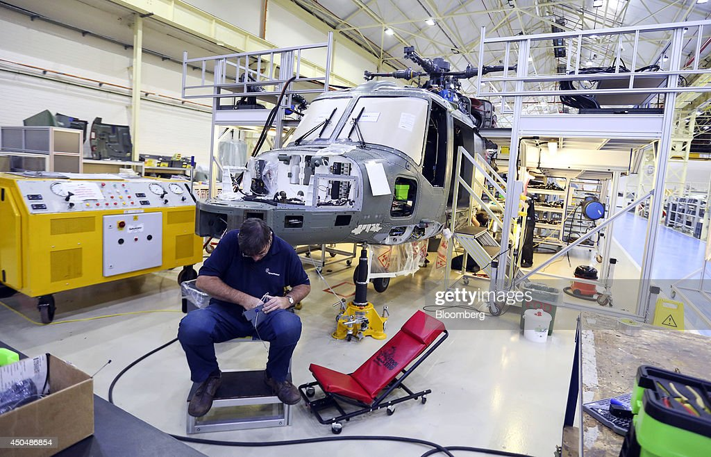 An employee assembles a part for a Super Lynx 300 helicopter, produced by AgustaWestland, a unit of Finmeccanica SpA, at the company's plant in Yeovil, U.K., on Thursday, June 12, 2014. U.K. unemployment declined more than expected and industrial production rose at the fastest annual pace since 2011, according to reports released this week. Photographer: Chris Ratcliffe/Bloomberg via Getty Images