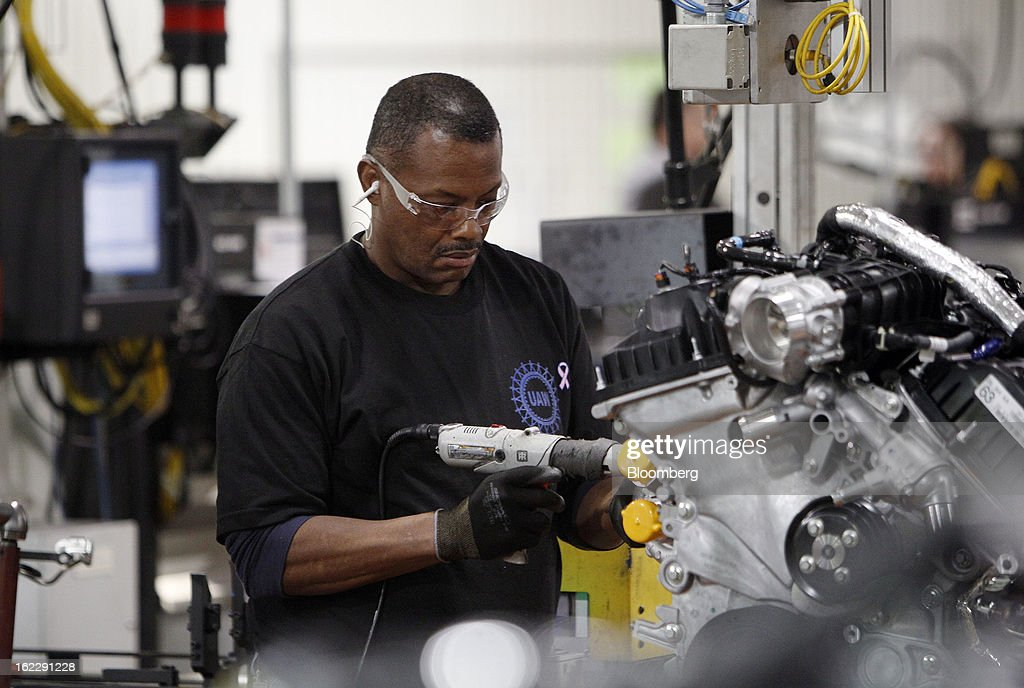 An employee assembles an 2.0 liter ecoboost engine on the production line at the Ford Motor Co. Cleveland Engine Plant in Brook Park, Ohio, U.S., on Thursday, Feb. 21, 2013. Ford Motor Co. said it will invest $200 million to make four-cylinder engines at the plant starting in late 2014 as the second-largest U.S. automaker equips an increasing number of models with smaller, more fuel-efficient powertrains. Photographer: David Maxwell/Bloomberg via Getty Images