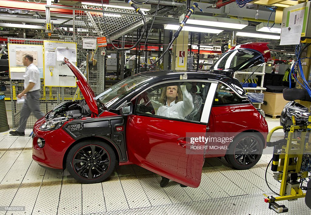 An employee assembles an Opel Adam car at the Opel plant in Eisenach, eastern Germany on January 10, 2013. The new Opel model will be produced as of January 10, 2013 at the Eisenach Opel plant and is intended to attract young automobile drivers in cities. Opel has already received 16 000 orders for the Adam.