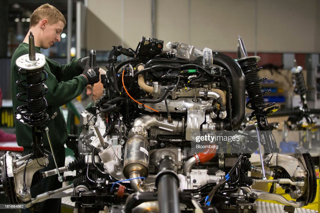 An employee assembles engine parts ahead of use at Jaguar Land Rover Plc's assembly plant, a unit of Tata Motors Ltd., in Halewood, U.K., on Wednesday, Feb. 13, 2013. Carmakers from Ford Motor Co. to Audi AG and Jaguar Land Rover Plc are using record amounts of aluminium to replace heavier steel, providing relief to producers of the metal confronting excess supplies and depressed prices. Photographer: Simon Dawson/Bloomberg via Getty Images