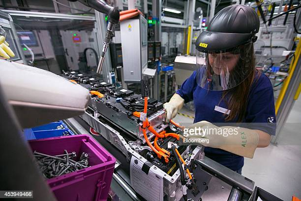 An employee assembles lithiumion battery modules at the Bayerische Motoren Werke AG automobile manufacturing plant in Dingolfing Germany on Thursday...
