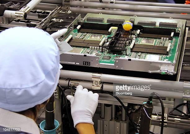 An employee assembles parts for a Fujitsu Ltd nextgeneration supercomputer at the Fujitsu IT Products Ltd plant in Hokuto City Ishikawa Prefecture...