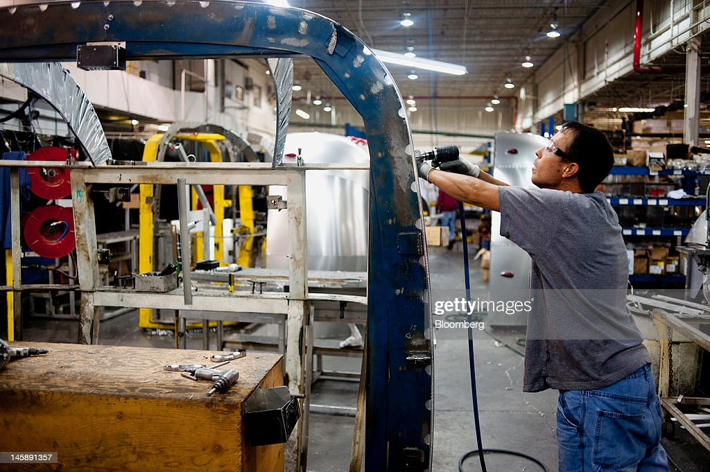 An employee assembles parts for a trailer at the Airstream Inc. manufacturing facility in Jackson Center, Ohio, U.S., on Wednesday, June 6, 2012. The U.S. Federal Reserve is scheduled to release industrial production data on June 15. Photographer: Ty Wright/Bloomberg via Getty Images