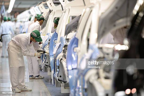 An employee assembles the Honda Motor Co Mobilio multipurpose vehicle at the PT Honda Prospect Motor factory in Karawang Indonesia on Wednesday Jan...