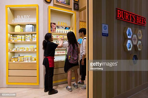 An employee assists customers at a Burt's Bees Inc store a subsidiary of Clorax Co in Seoul South Korea on Thursday July 2 2015 At a time when large...