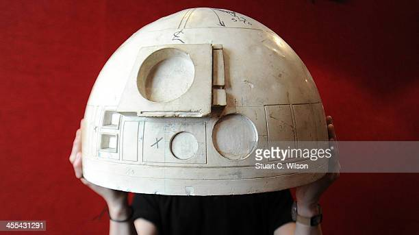 An employee at Bonham's auction house holds a study mould for the dome of R2D2's head which was used in Star Wars A NEW HOPE at Bonham's on December...