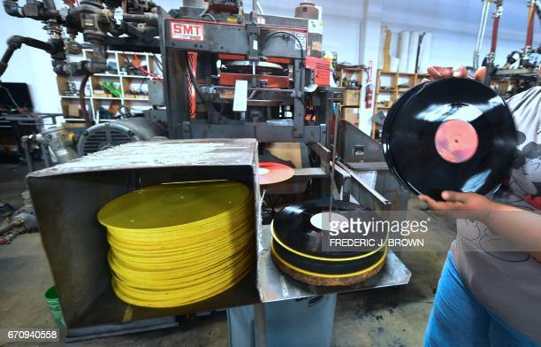 An employee at Erika Records works in the record pressing plant in Buena Park California on April 12 where Erika Records has been pressing vinyl in...