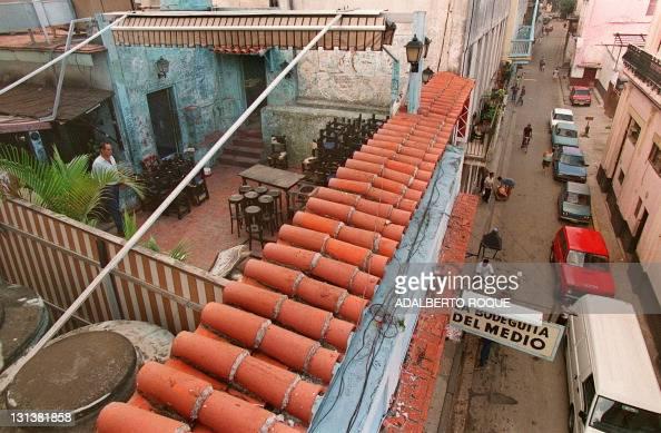 An employee at 'La Bodeguita del Medio' Havana's bestknown bar walks on the rooftop terrace of the bar 05 September a few hours after an bomb...