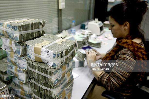 MOUSSAOUI An employee at Lebanon's Central Bank counts money bills at her office in Beirut on November 24 2008 Lebanon for now has managed to steer...