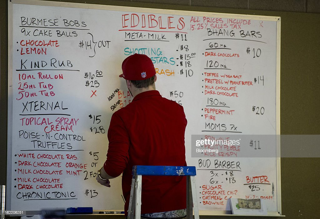 An employee at MedMar Health Center, a medical-marijuana dispensary, adds items to the menu bulletin board in San Jose, California, U.S., on Thursday, Feb. 7, 2013. San Jose is the medical-marijuana capital of Silicon Valley with 106 clinics, about twice as many per square mile as Los Angeles. Photographer: David Paul Morris/Bloomberg via Getty Images