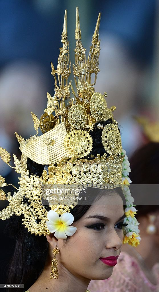 An employee at the Cambodia stand wears an intricate head piece at the ITB International Travel Trade Fair in Berlin March 5, 2014. The ITB opens from March 5 to 9, 2014.
