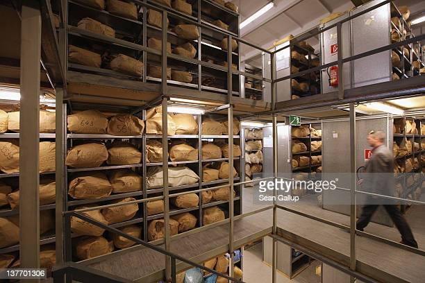 An employee at the request of the photographer of the federal archive responsible for the files of the former East German secret police the Stasi...