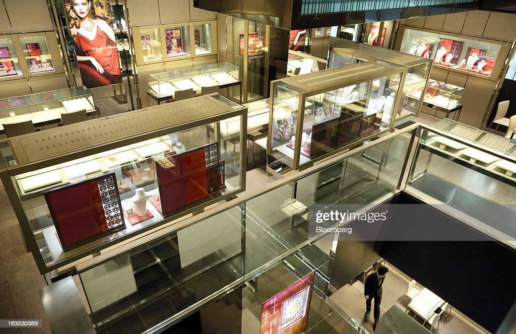 An employee, bottom right, waits for customers at the Chow Sang Sang Holdings International Ltd. jewelry store in the Sanlitun district of Beijing, China, on Monday, March 11, 2013. China's consumer prices climbed 3.2 percent from a year earlier, according to figures released March 9, exceeding January's 2 percent gain and the median estimate for a 3 percent increase in a Bloomberg survey of analysts. Photographer: Tomohiro Ohsumi/Bloomberg via Getty Images