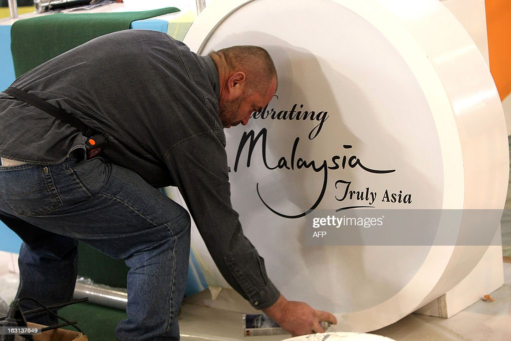 An employee builds the stand for Malaysia at the ITB Berlin tourism convention (Internationale Tourismus-Boerse) prior to its opening in Berlin on March 5, 2013. The ITB Berlin runs from March 6-10 and features Indonesia as its partner country for the event in 2013.