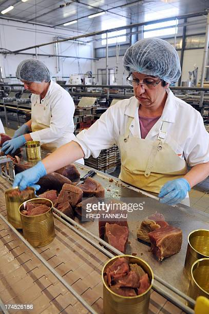 An employee cans tuna on July 8 2013 at the Gonidec canning fish factory in Concarneau western of France Gonidec canning fish factory in Concarneau...