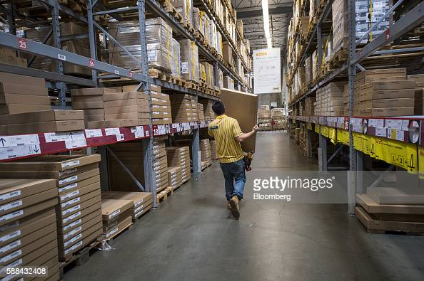An employee carries a box inside an IKEA AB store in Emeryville California US on Tuesday Aug 9 2016 The US Census Bureau is scheduled to release...