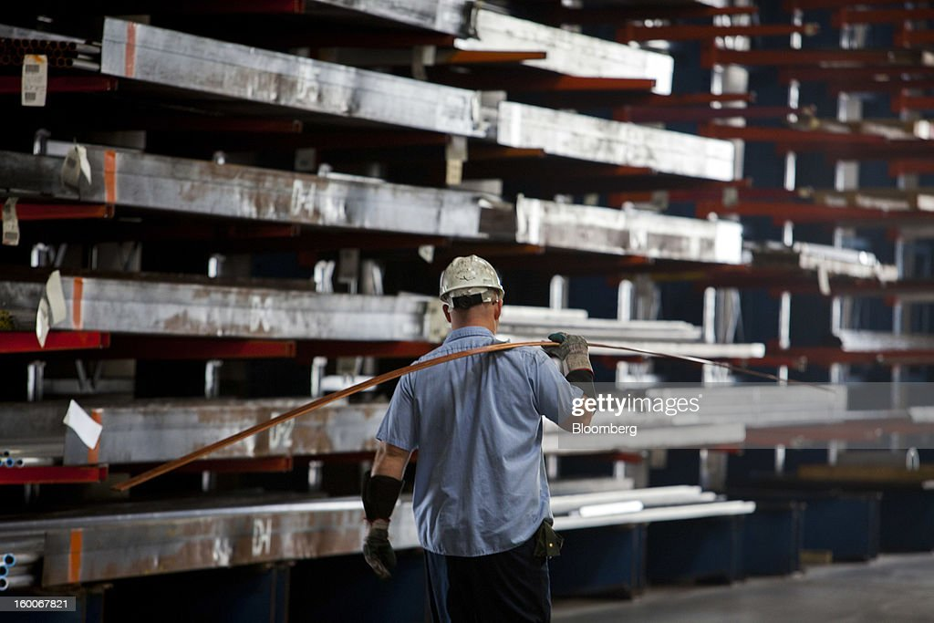 An employee carries copper at Industrial Metal Supply Co.'s warehouse in San Diego, California, U.S., on Thursday, Jan. 24, 2013. Industrial Metal Supply Co. is an aluminum, steel and sheet metal supplier serving businesses and retail custmers. Photographer: Sam Hodgson/Bloomberg via Getty Images
