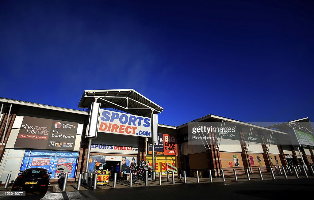An employee carries out a boxed bicycle for display ahead of opening at a Sports Direct International Plc store in Urmston, U.K., on Saturday, Oct. 6, 2012. JJB Sports Plc, a U.K. sporting goods retailer, will close most of its stores with the remaining 20 being acquired by competitor Sports Direct International Plc, according to a statement from KPMG LLP, which was appointed as administrator to the Wigan, England-based company. Photographer: Paul Thomas/Bloomberg via Getty Images