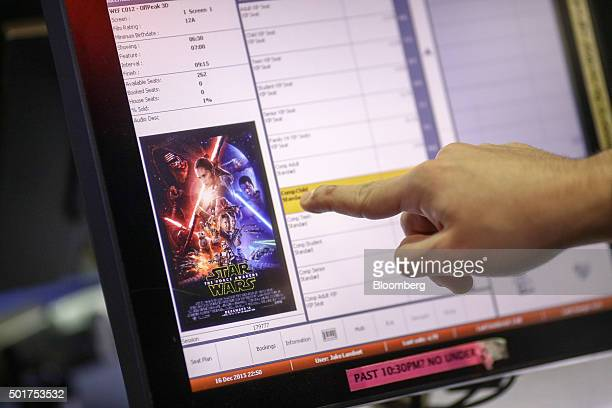 An employee check his computer for available tickets at the first public screening of Walt Disney Co's 'Star Wars The Force Awakens' at a Vue...