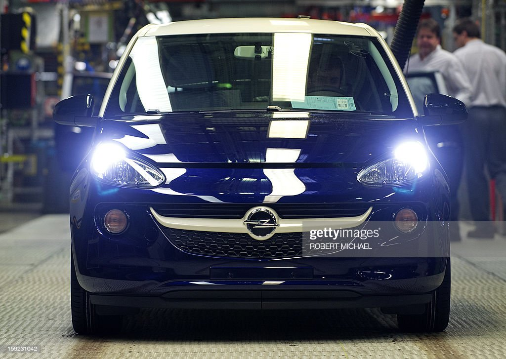 An employee checks a newly fabricated Opel Adam car at the Opel plant in Eisenach, eastern Germany on January 10, 2013. The new Opel model will be produced as of January 10, 2013 at the Eisenach Opel plant and is intended to attract young automobile drivers in cities. Opel has already received 16 000 orders for the Adam.