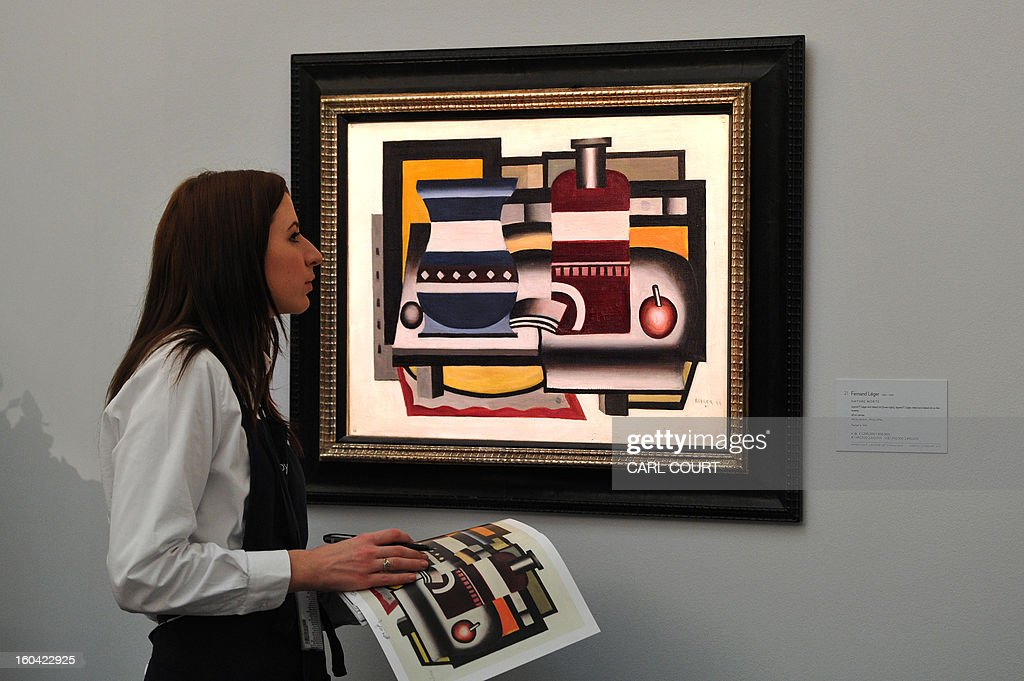 An employee checks a painting entitled 'Nature Morte' by French artist Fernand Leger at Sotheby's auction house in central London on January 31, 2013. Due to form part of the Impressionist and Modern Art Evening Sale on February 5, it is expected to fetch between 1-2 million GBP (1.4-2.2 million EUR - 2-3 million USD).