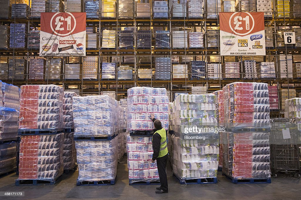 An employee checks a pallet of goods ahead of shipping inside Poundland's goods distribution warehouse, operated by Poundland Holdings Ltd., in Bilston, U.K., on Friday, Dec. 20, 2013. U.K. discount retailer Poundland has hired Rothschild to manage its IPO, according to the Sunday Times newspaper. Photographer: Simon Dawson/Bloomberg via Getty Images