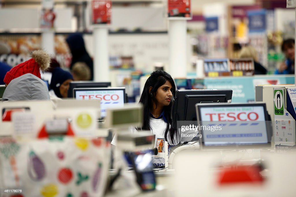 An employee checks a selfserve checkout desk inside a Tesco supermarket store operated by Tesco Plc in the Kensington district of London UK on...