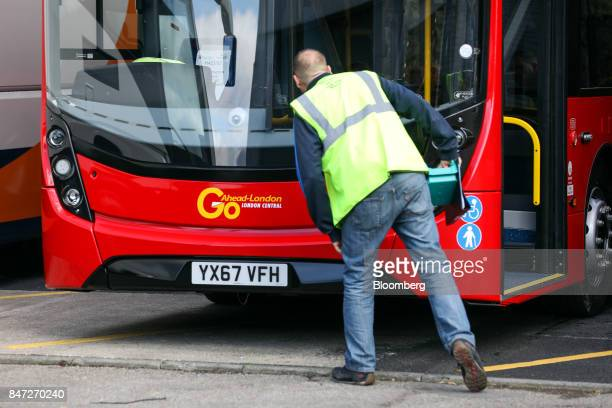 An employee checks an identification sheet on an Enviro 400 bus to be used by GoAhead Group Plc in London at the Alexander Dennis Ltd factory in...