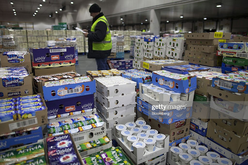 An employee checks goods ahead of transporting to a supermarket, inside WM Morrison Supermarkets Plc's distribution center in Wakefield, U.K., on Thursday, Nov. 22, 2012. Britain's economy will return to growth next year after stagnating in 2012, with expansion weighted in the second half, according to Bank of England projections published yesterday. Photographer: Simon Dawson/Bloomberg via Getty Images