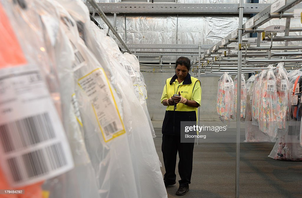 An employee checks her scanning device as she scans clothing wrapped in plastic covers at the Myer Holdings Ltd. distribution center in Melbourne, Australia, on Tuesday, Sept. 3, 2013. A Bureau of Statistics report released in Sydney on Sept. 4 showed household spending climbed 0.4 percent in the second quarter, adding 0.2 percentage point to gross domestic product growth. Photographer: Carla Gottgens/Bloomberg via Getty Images