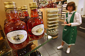 An employee checks inventory next to a shelf of strawberry vinegar at the KaDeWe luxury department store on April 21 2009 in Berlin Germany German...