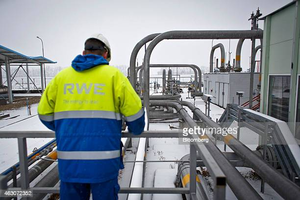 An employee checks outdoor pipework at the underground gas storage facility operated by RWE AG in Dolni Dunajovice Czech Republic on Monday Feb 9...