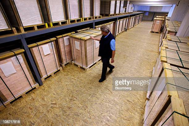 An employee checks pallets of completed cottonbased security paper in the secure storage facility at the Landqart AG paper mill in Landquart...