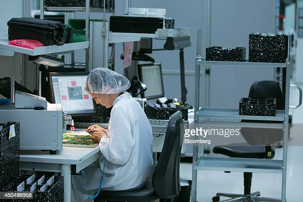 An employee checks photo display panels inside the Leica Camera AG factory as the company celebrates their 100th anniversary in Wetzlar Germany on...