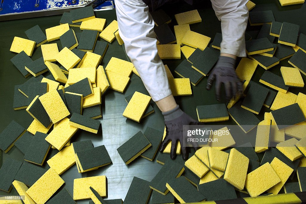 An employee checks sponges at the factory of French sponge brand Spontex on December 19, 2012 in Beauvais.