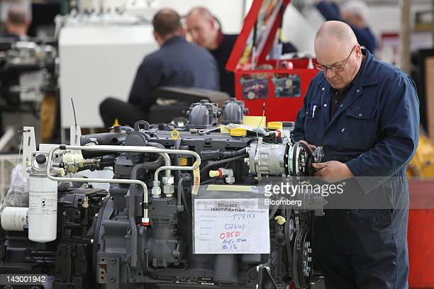 An employee checks the engine of an aviation towing tractor at the Douglas Equipment plant owned by CurtissWright Corp in Cheltenham UK on Tuesday...