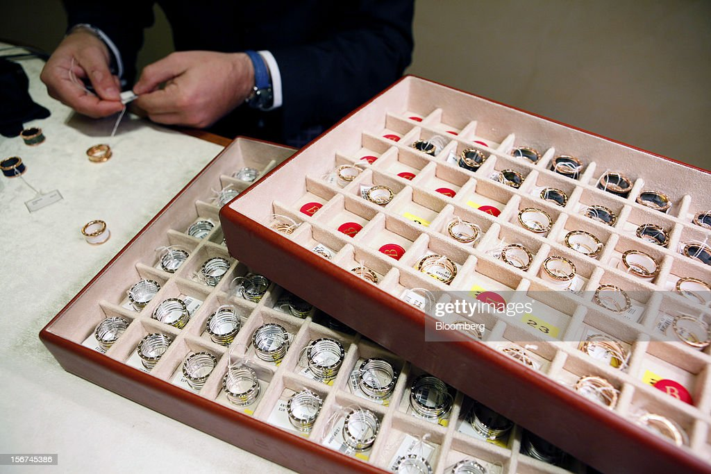 An employee checks the tags on Bulgari 'b01' rings inside Bulgari SpA's store, a luxury unit of LVMH Moet Hennessy Louis Vuitton SA, in Rome, Italy, on Monday, Nov. 19, 2012. Last year's acquisition of Bulgari 'has brought a lot of jewelry know-how' to the company, said Francesco Trapani, president of LVMH's watch and jewelry division, who joined the Paris- based luxury-goods maker as part of the deal. Photographer: Alessia Pierdomenico/Bloomberg via Getty Images