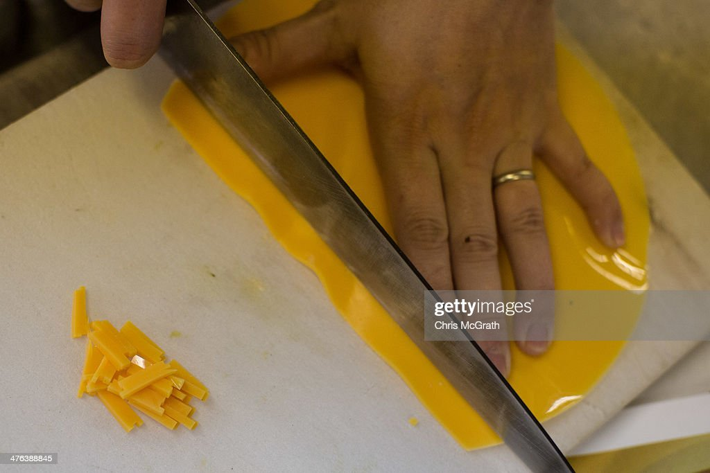 An employee chops cheese food samples made of vinyl at the Iwasaki Co., LTD sample food factory on March 3, 2014 in Yokohama, Japan. Sample food products can be seen in the windows of many restaurants throughout Japan. The factory creates precision replica food plates moulded from real food supplied by the client. The Iwasaki Co., LTD facility is one of the largest suppliers in Japan, producing approximately 270,000 sample plates per year to over 20,000 food outlets across Japan and internationally.